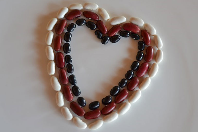 A seed farmer on why she donates to SeedChange - image of three different colour beans arranged in the shape of a heart.