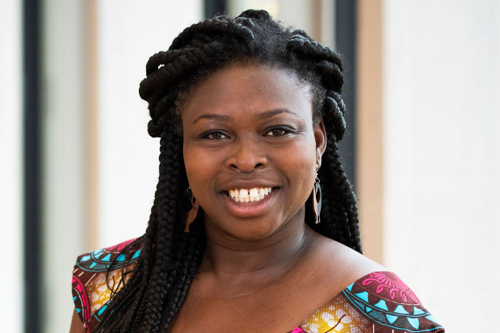 Welcome Leticia Ama Deawuo SeedChange's new executive director - A photo headshot of Leticia Ama Deawuo smiling and looking into the camera.